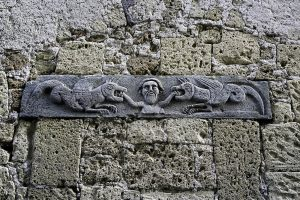 Photography of Ancient bas-relief detail in Pitigliano
